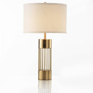 Modern simple personality creative table lamp foyer bedroom study American model room gold Iron luxury art LED reading lamp