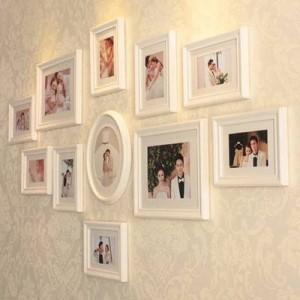 Combinazione creativa di eleganti cornici per foto in legno in stile europeo